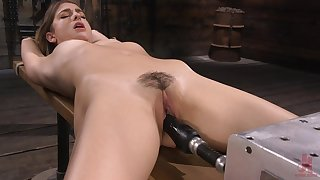 Kristen has a fucking machine in her pussy and become absent-minded girl is so sweet