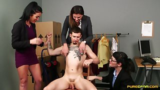 Tattooed man gets his dick stroked by Eva Johnson and friends